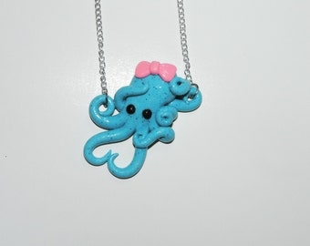 blue octopus necklace with pink bow,  semi translucent, opalescent, sparkly, glitter, specks, spots, pastel