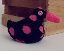 Sock Duck Made From a Black Sock With Pink Dots And Adorned With Button Eyes and Filled With Plastic Pellets for Weight and a Pink Sock Beak