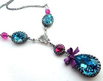 Aqua fuchsia crystal necklace, antiqued silver bezel set rhinestones with bow, all Austrian crystal, purple enamel bow, aqua crystal jewelry