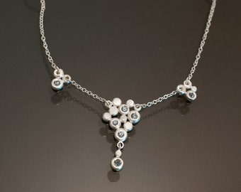 Light blue-green sapphire and sterling silver necklace