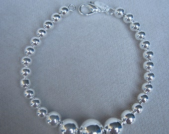 "Silver Single Strand of Graduated High Polish Beaded 8"" Silver Bracelet"