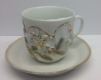 Vintage Mustache Cup with 6 inch saucer Embossed with white, silver and gold