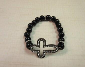 Black onyx beaded bracelet with black jeweled sideway cross.