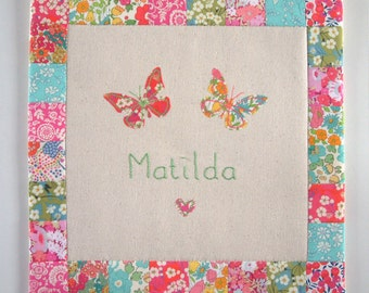 Personalised wall hanging or cushion, you choose. Liberty cotton prints patchwork border and butterflies. Embroidered name. Handmade gift.