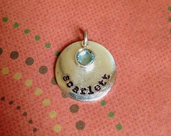A la carte rectangle or circle tag with name and stone or pearl.  No chain, just an extra pendant.