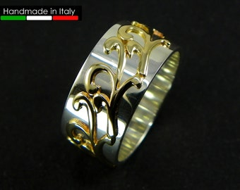 Silver band ring with 14 kt gold decoration