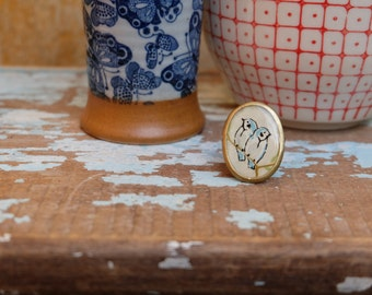 Birds antique brass oval ring with japanese chiyogami paper and resin