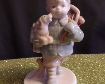 Vintage Russ Berrie Marabella Collection Porcelain Figurine of Boy Holding His Sled and Puppy