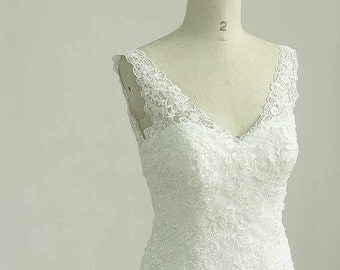 Open back Deep v neckline fit and flare Ivory lace wedding dress