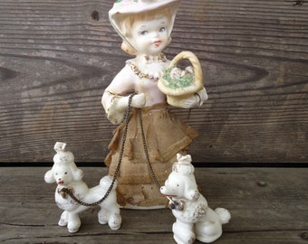 Porcelain Girl with Poodles Figurines