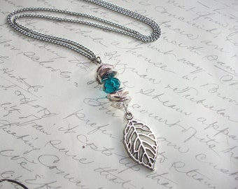 Long leaf necklace with blue crystal