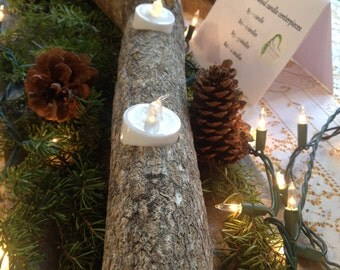 Rustic repurposed log candle centerpeices