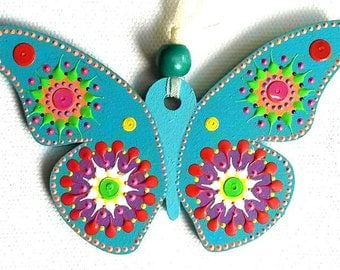 Single turquoise Butterfly hanging decoration (iii). Hand painted and sequin embellished by Artichicks.