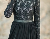Black a-line high-necked lace wedding dress with long sleeves and flowing layered chiffon skirt