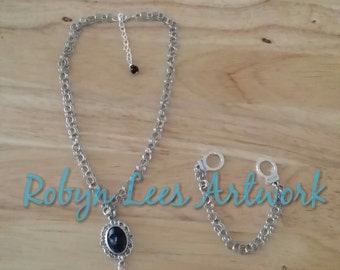 Antiqued Silver Rope Chain Link Necklace With Black Tribal Face Cabochon and Silver Music Note
