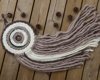 Round woven wall hanging