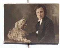 Mannish suit, photograph c1920s, Art Deco fashion, large cabinet card, tinted portrait, girl in tuxedo, flapper bob, Bichon Frise