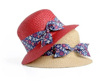 Custom hats , Straw cloche hat , Sun hat , Woman's Short brimmed hat , decorated with a ribbon and a bow.