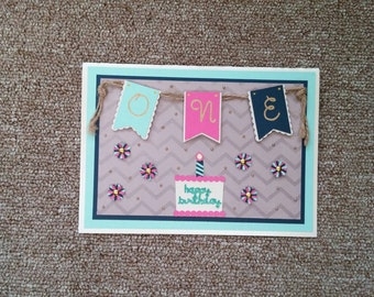 first birthday cake and banner card