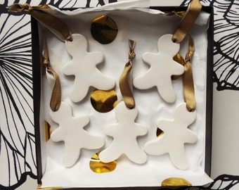 Five handmade porcelain gingerbread people christmas decorations. Handmade festive ornaments in white.
