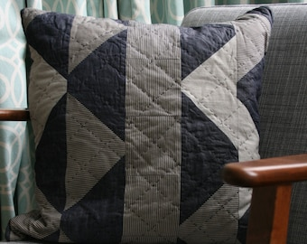 Quilted stripes cushion