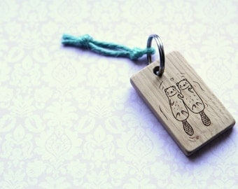 Wood key chain. Otters holding hands. Never drift apart. Custom personalised. Significant.