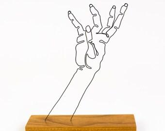 Zombie hand wire sculpture