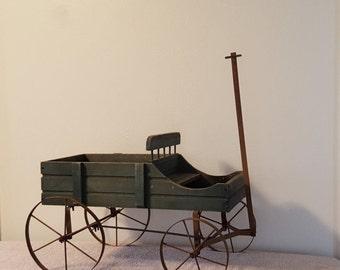 Weathered Green Wood Wagon with Rusty Wheels