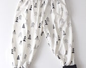 Tribal black and white hand drawn tree pattern harem pants for babies and toddlers.