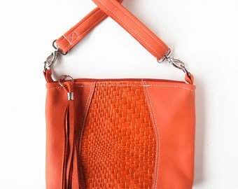 Leather crossbody purse, soft rust color with woven leather inset.