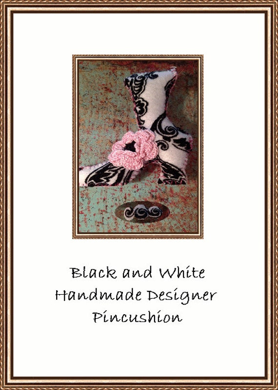 Here is A High Stepping Victorian Black and White Designer Pincushion
