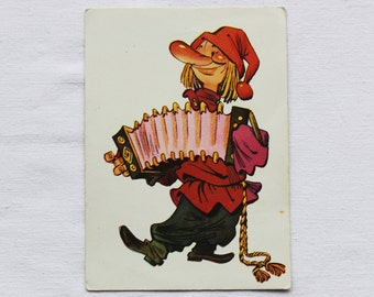 "Illustrator Migunov Vintage Soviet Postcard ""Petrushka"" - 1971. Sovetskiy hudozhnik. Actor, Garmon , Red, Cap, Shirt, Trousers"