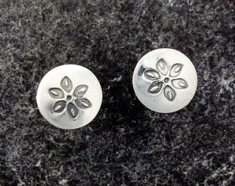 Flower stud earrings in sterling silver.