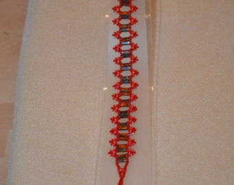 Riverwalk bracelet in opaque orange and red beads 8 inches long