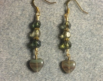 Green Czech glass heart bead dangle earrings adorned with green Czech glass beads.