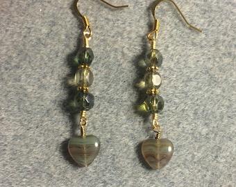 Green Czech glass heart bead dangle earrings adorned with green Czech glass beads.