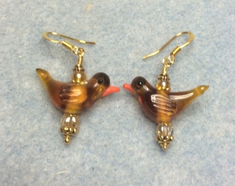 Topaz lampwork songbird dangle earrings adorned with topaz Czech glass beads.