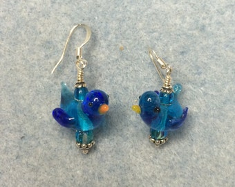 Turquoise blue songbird lampwork dangle earrings adorned with turquoise blue Czech glass beads.