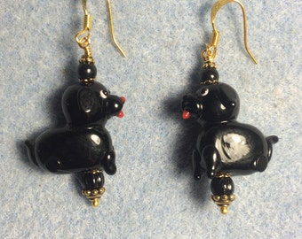 Black lampwork puppy dog bead earrings adorned with black Czech glass beads.