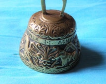 Antique Solid Brass Bell   . Lovely old well loved bell decorated with animals