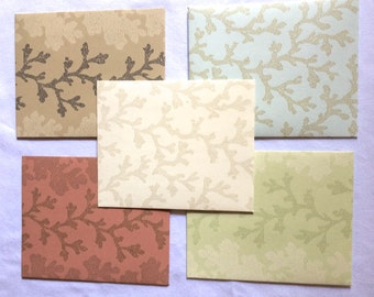 5 Handmade Upcycled Wallpaper Pocket Envelopes-  4.25 x 5.25 inches- brown, tan, light green, light blue, coral