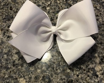 6 in boutique hair bow on an attached alligator clip.