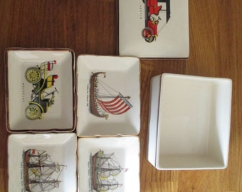 vintage sandland ware pin dishes within a case , male theme ref 2