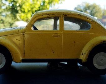 Early 1960s Yellow VW Bug made by TONKA