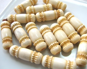 Carved bone beads, 9 beads, 9x27mm, vintage beads - 556