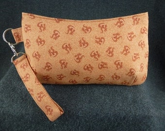 """For the Yoga lovers!  Cute wristlet / clutch made with """"om"""" yoga fabric."""