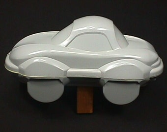 Vintage Futuristic Plastic Car Model Sealed Together, and Ready for Paint
