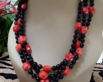 Three strand necklace made with faceted black onyx and red artist faceted cut glass