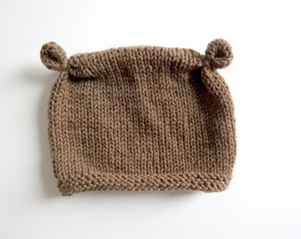Handknitted hat for baby in natural wool - brown