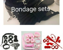Bdsm mature content bondage set faux leather and faux fur lined cuffs, collar, anklets, ball gag, whip, eye mask, rope, chain